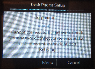 A photo of the Desk Phone Setup screen attempting to reconnect to the network